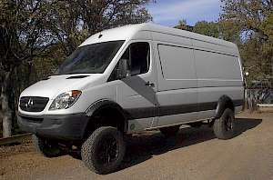 Completed conversion with 12.5 inch by 35 inch tall tires under a Sprinter 170 inch wheelbase hi top. Approx. 11 feet to the top. Front track was widened by 12 inches, rear by 14 inches, total lift is 9 inches