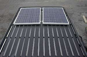 Roof rack with walk on slat floor and solar