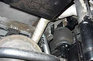 Aux. air suspension under a 4x4 class C RV, includes driver seat controls, onboard compressor